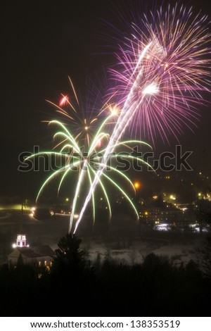 Fireworks over Stowe Village in the winter, Stowe, Vermont, USA