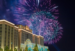 Fireworks over the Christmas (New Year) holidays illumination and Building of The State Duma of the Federal Assembly of Russian Federation at night, Moscow, Russia
