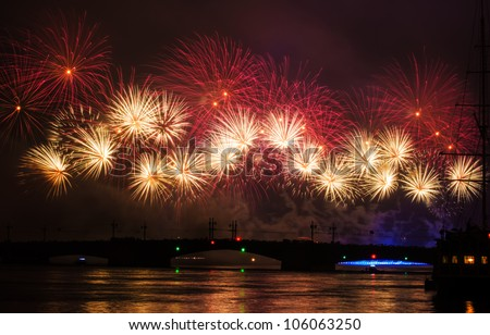 "Fireworks over the city of St. Petersburg (Russia) on the feast of ""Scarlet Sails"", in the rain with fog and smoke. View of the Palace Bridge with people and part of the sailboat."