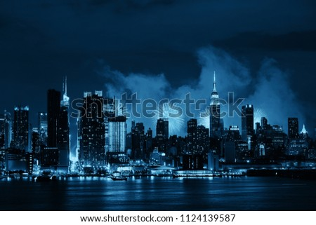 Fireworks show with Manhattan midtown skyscrapers and New York City skyline at night #1124139587