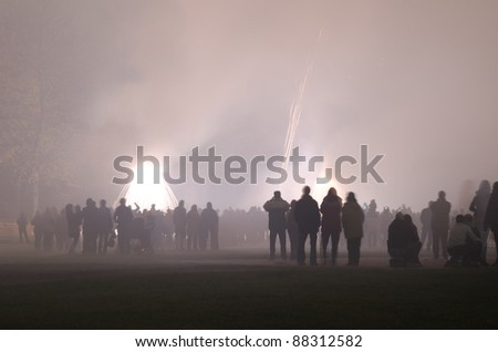 fireworks, spectators in thick fog