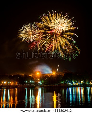 fireworks with reflection in the lake