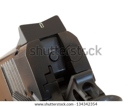 Firing pin on a semi automatic handgun near the rear sight