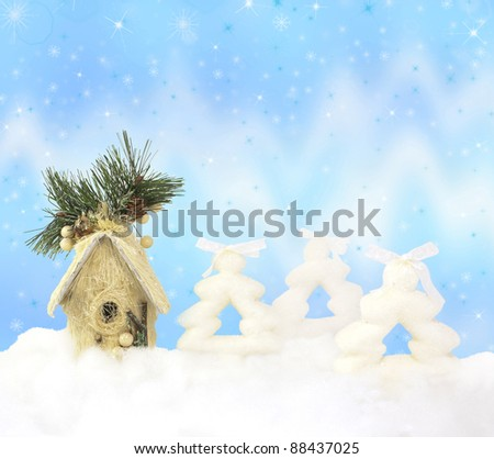 Firs, house and northern lights on sparkle Christmas background