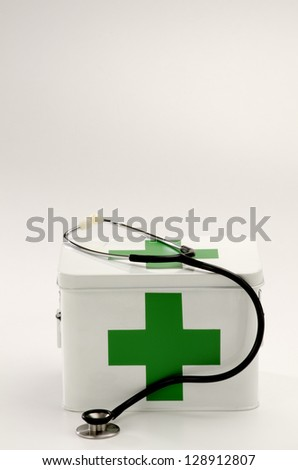 First aid box and a stethoscope in white background