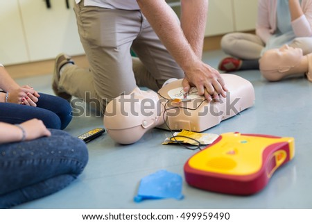 First aid cardiopulmonary resuscitation course using automated external defibrillator device, AED. #499959490