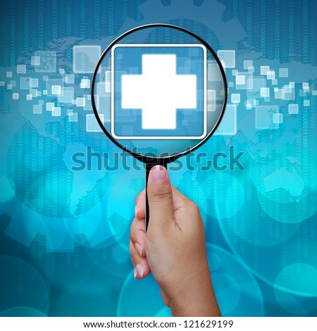 First Aid icon in Magnifying glass on blue background