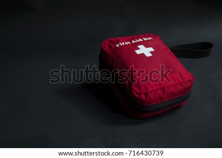 first aid kit on black back #716430739