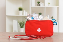 First aid kit on table in clinic