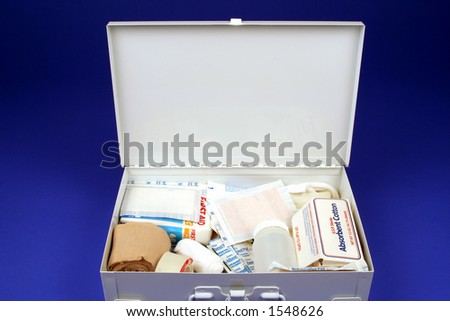 First aid kit open on a blue background