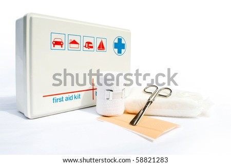 First aid kit with bandages and scissors on white background