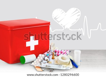 First aid kit  with medical supplies on background #1280296600