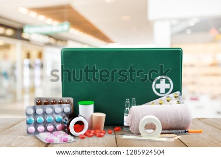First aid kit  with medical supplies on background #1285924504