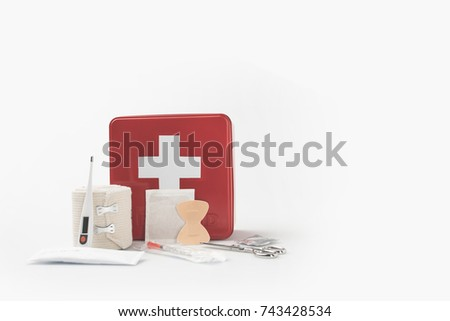 first-aid kit with white cross and medical supplies  #743428534