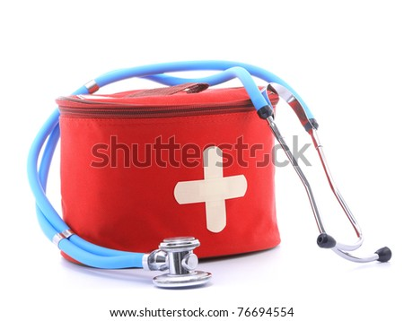 First-aid kit with white cross as two crossed band-aid slips and blue stethoscope over white background