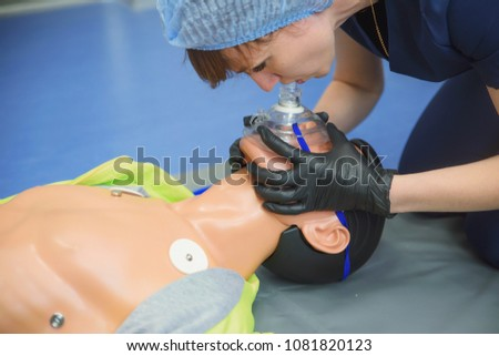 first aid measures for victims, basic emergency training, artificial lung ventilation, indirect heart massage #1081820123