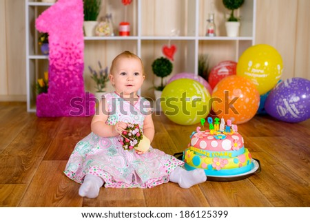 First birthday of little baby girl - stock photo