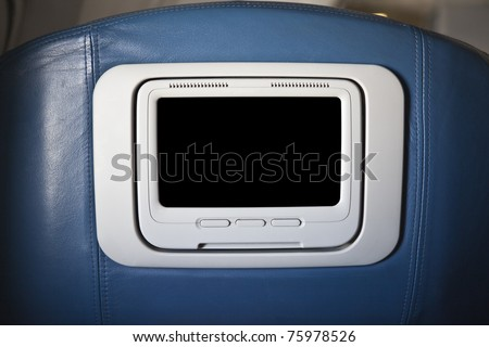 First class seat back with monitor on a common jet aircraft.