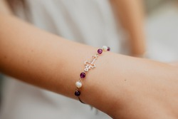 First communion bracelet with a silver cross
