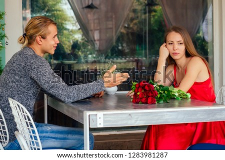 first date spending time together ignoring real communication bored conversation disappoint couple in restaurant, bad relationship Young bored girl and male sitting on date at cafe. Speed dating