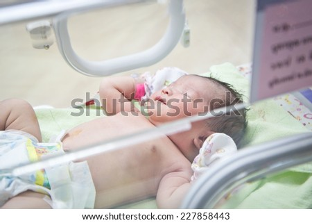 first day of asian newborn baby in Incubator care at nursery hospital