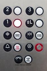 First floor button inside an elevator illuminated.