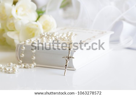 First holy communion symbol background concept with rosary and flowers #1063278572