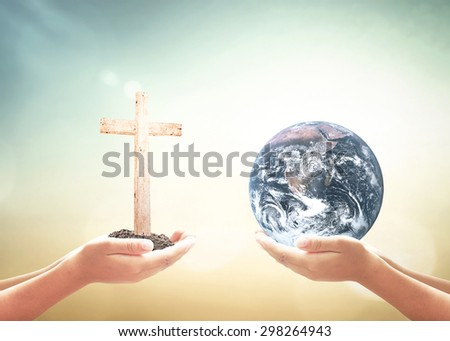 First, human hands holding the white cross. Second, human hands holding Blue planet over nature background. Elements of this image furnished by NASA.