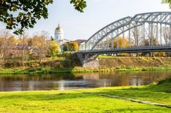 First in Russia steel arch bridge across the Msta river in sunny summer day. Was built in 1905. Borovichi, Russia