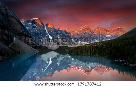 First light of dawn at Moraine Lake with golden sunrise over the Valley of the Ten Peaks in the Canadian Rockies of Banff National Park. Photo stock ©