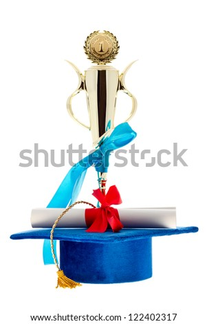 First place golden winner cup, blue graduate cap & diploma with a red ribbon isolated on white/Wins of education
