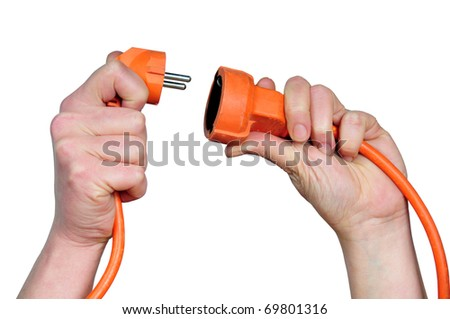 first plane of hands with plugs on white bottom - stock photo