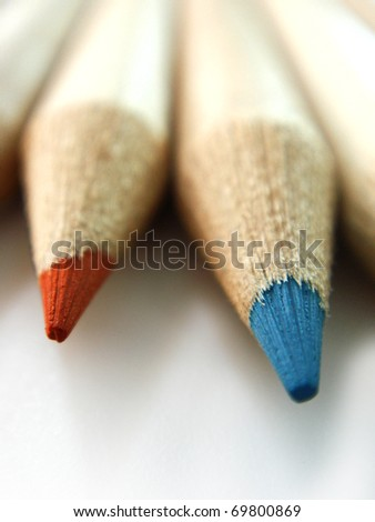 first plane of the tip of pencils of colors on white bottom