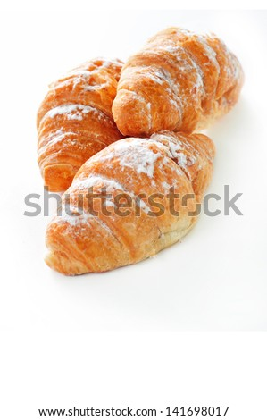 first plane of three croisants, with sugar glass