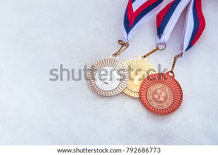 First, second, third place. Medal set, white winter background. Photo for winter olympic game.