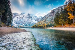 First snow in the mountains. Picturesque autumn view of Braies Lake. Stunnig morning scene of Dolomiti Alps, Naturpark Fanes-Sennes-Prags, Italy, Europe. Beauty of nature concept background.