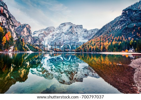 First snow on Braies Lake. Colorful autumn landscape in Italian Alps, Naturpark Fanes-Sennes-Prags, Dolomite, Italy, Europe. Beauty of nature concept background. - Shutterstock ID 700797037