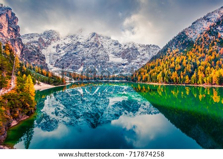 First snow on Braies Lake. Colorful autumn landscape in Italian Alps, Naturpark Fanes-Sennes-Prags, Dolomite, Italy, Europe. Beauty of nature concept background.  - Shutterstock ID 717874258