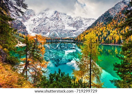 First snow on Braies Lake. Colorful autumn landscape in Italian Alps, Naturpark Fanes-Sennes-Prags, Dolomite, Italy, Europe. Beauty of nature concept background.  - Shutterstock ID 719299729