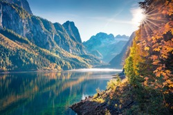 First sunlight glowing mountain lake anf cliffs. Spectacular autumn scene of Vorderer/Gosausee lake. Nice morning view of Austrian Alps, Upper Austria, Europe. Beauty of nature concept background.