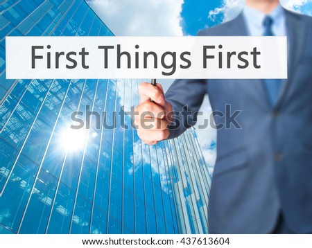 First Things First - Businessman hand holding sign. Business, technology, internet concept. Stock Photo #437613604
