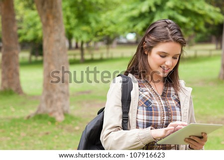 First-year student using a touch pad in a park