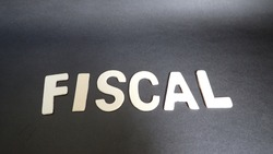 fiscal letter on black background. Concept for business, finance and art.