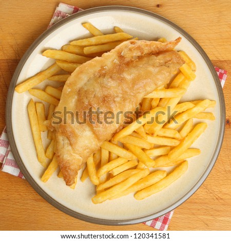 Fish & chips. Crispy cod in batter with fries. - stock photo
