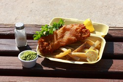 Fish and Chips at the waterside. The Cod or Haddock is coated in Beer Batter which consists of flour turmeric and Lager beer with sparkling water generating a deep golden brown crispy texture.