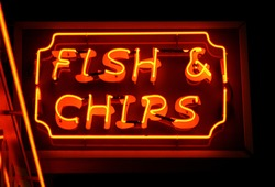fish and chips neon sign at night