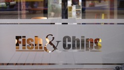 fish and chips sign etched on glass window