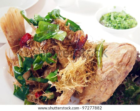 Fish and herbs. - stock photo