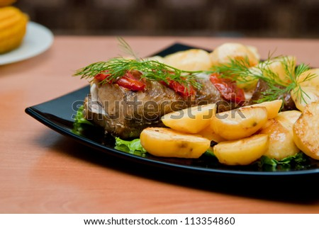 Fish and roasted potato on a plate