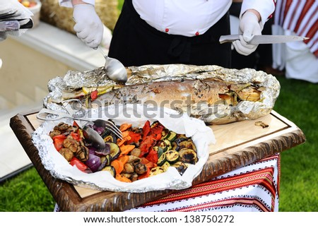Fish baked in foil and grilled vegetables.